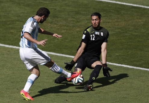 argentinas-gonzalo-higuain-fails-to-get-the-ball-past-irans-goalkeeper-alireza-haqiqi
